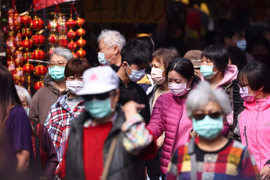 People shop while wearing a protective mask ahead of the Lunar New Year holiday in Taipei, Taiwan, 10 February 2021. (Ann Wang/Reuters)