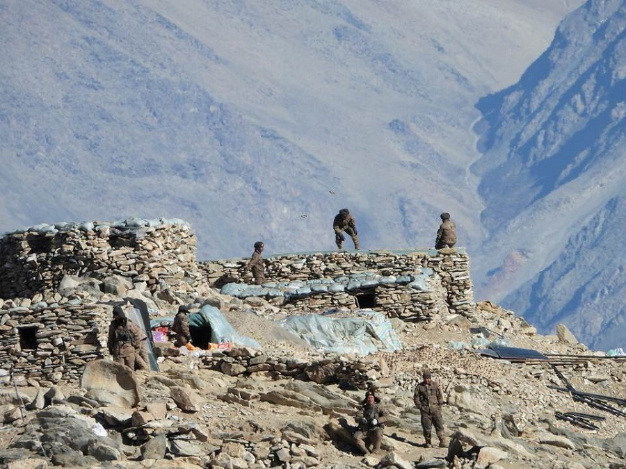 A handout photo released by the Indian Army on 16 February 2021 shows the disengagement process between the Indian Army and China's People's Liberation Army from a contested area in the western Himalayas, in Ladakh region. (Indian Army/Handout via Reuters)