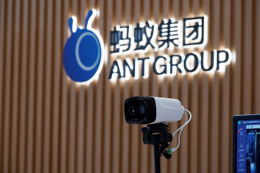 A thermal imaging camera is seen in front of a logo of Ant Group at the headquarters of Ant Group, an affiliate of Alibaba, in Hangzhou, Zhejiang province, China, 29 October 2020. (Aly Song/File Photo/Reuters)