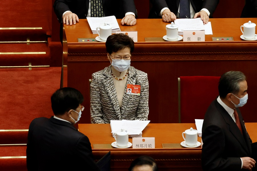 Hong Kong Chief Executive Carrie Lam sits before the opening session of the National People's Congress (NPC) at the Great Hall of the People in Beijing, China, 5 March 2021. (Carlos Garcia Rawlins/Reuters)