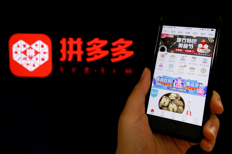 The logo of Chinese online group discounter Pinduoduo is seen next to its mobile phone app in this illustration picture taken 17 July 2018. (Florence Lo/Illustration/File Photo/Reuters)