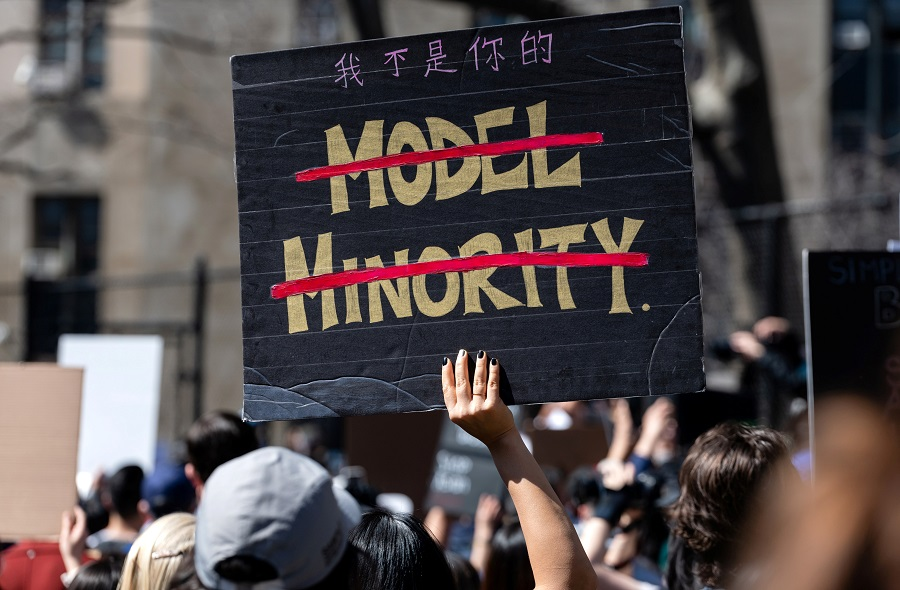 A person holds a sign during a rally against hate to end discrimination against Asian Americans and Pacific Islanders in New York City, US, 21 March 2021. (Eric Lee/Reuters)