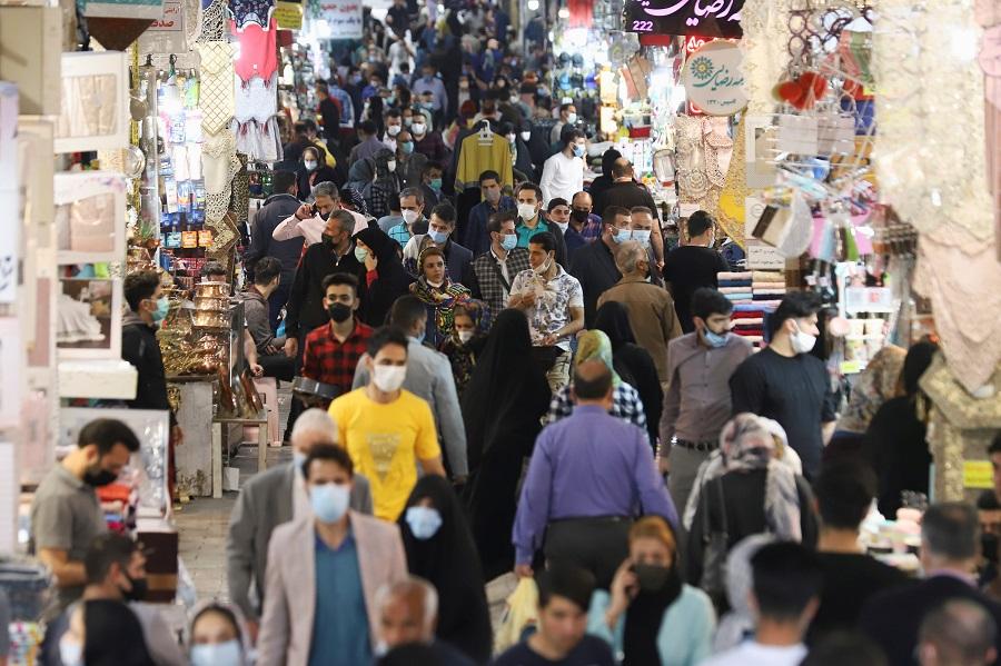 People walk in Tehran Bazaar, in Tehran, Iran, 6 April 2021. (Majid Asgaripour/West Asia News Agency via Reuters)