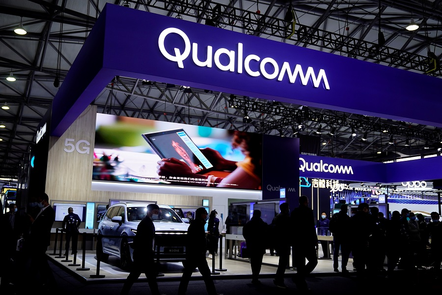People visit a Qualcomm booth at the Mobile World Congress (MWC) in Shanghai, China, 23 February 2021. (Aly Song/File Photo/Reuters)