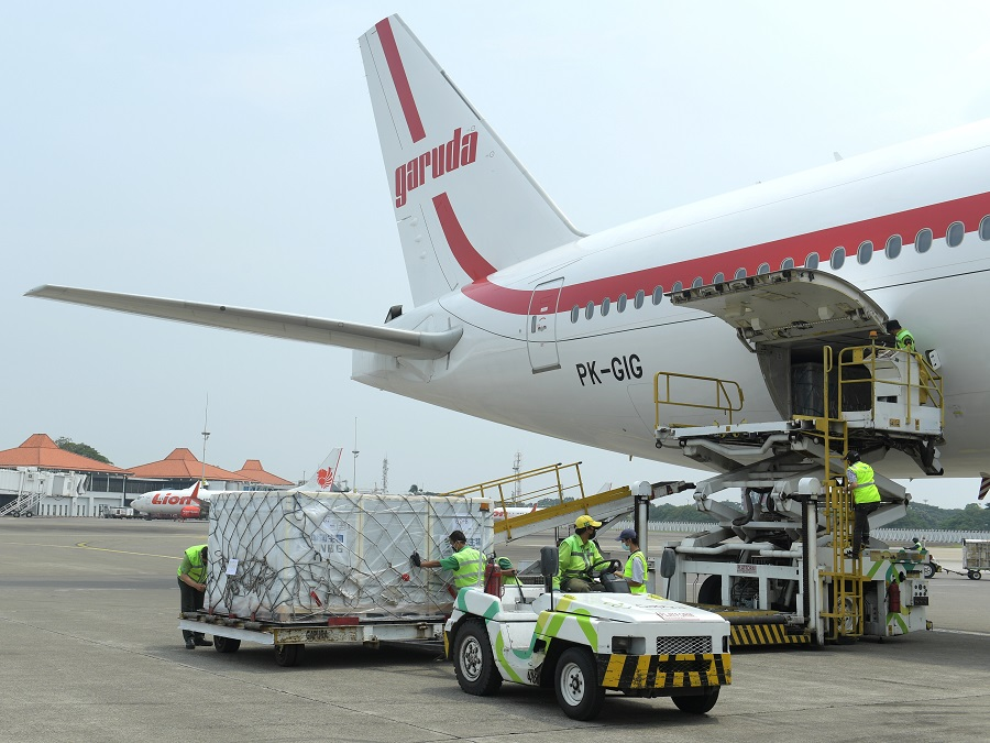 Workers unload a consignment of China's Sinovac Biotech Covid-19 vaccine as it arrives at the Soekarno-Hatta International Airport in Tangerang, on the outskirts of Jakarta, Indonesia, 30 April 2021. (Kris/Courtesy of Indonesian Presidential Palace/Handout via Reuters)