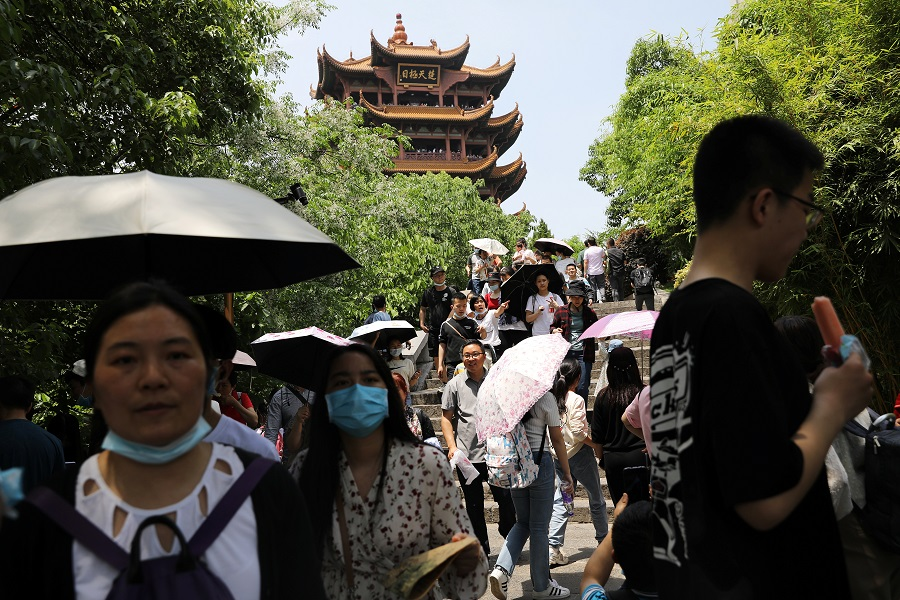 Visitors walk near the Yellow Crane Tower during the Labour Day holiday in Wuhan, Hubei province, China, 2 May 2021. (Tingshu Wang/Reuters)