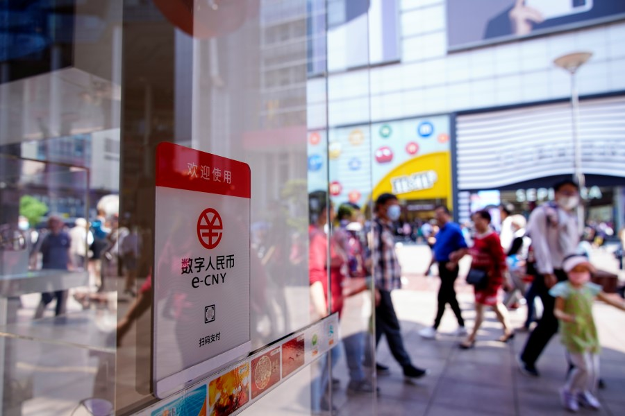 A sign indicating digital yuan, also referred to as e-CNY, is pictured at a shopping mall in Shanghai, China, 5 May 2021. (Aly Song/Reuters)