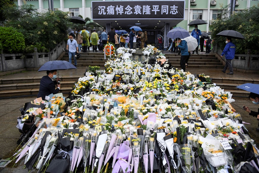 Flowers are laid at a makeshift memorial to mourn Yuan Longping, a Chinese agronomist known for developing the first hybrid rice varieties in the 1970s, at Hunan Hybrid Rice Research Center in Changsha, Hunan province, China, 23 May 2021. (CNS photo via Reuters)