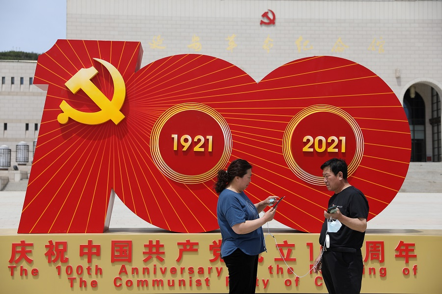 Visitors stand in front of an installation marking the 100th founding anniversary of the Communist Party of China at Yan'an Revolution Memorial Hall during a government-organised tour in Yan'an, Shaanxi province, China, 10 May 2021. (Tingshu Wang/Reuters)