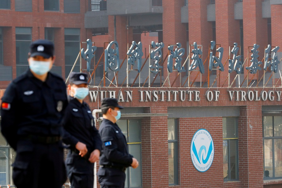 Security personnel keep watch outside the Wuhan Institute of Virology during the visit by the World Health Organization (WHO) team tasked with investigating the origins of the Covid-19 coronavirus, in Wuhan, Hubei province, China, 3 February 2021. (Thomas Peter/File Photo/Reuters)