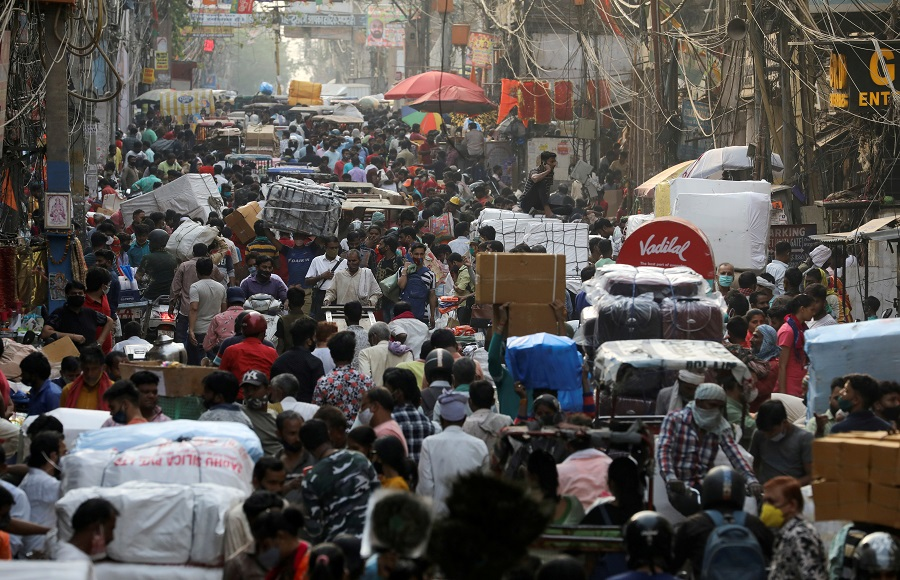 People walk at a crowded market amidst the spread of the Covid-19 coronavirus, in the old quarters of Delhi, India, 6 April 2021. (Anushree Fadnavis/File Photo/Reuters)