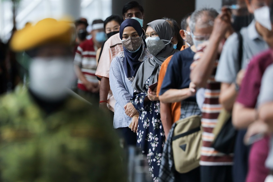 People wait to receive Covid-19 vaccines at a vaccination centre in Kuala Lumpur, Malaysia, 31 May 2021. (Lim Huey Teng/Reuters)