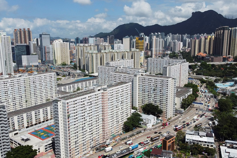 An aerial view shows Choi Hung public housing estate and other residential buildings with the Lion Rock peak in the background, in Hong Kong, China, 3 June 2021. (Joyce Zhou/Reuters)
