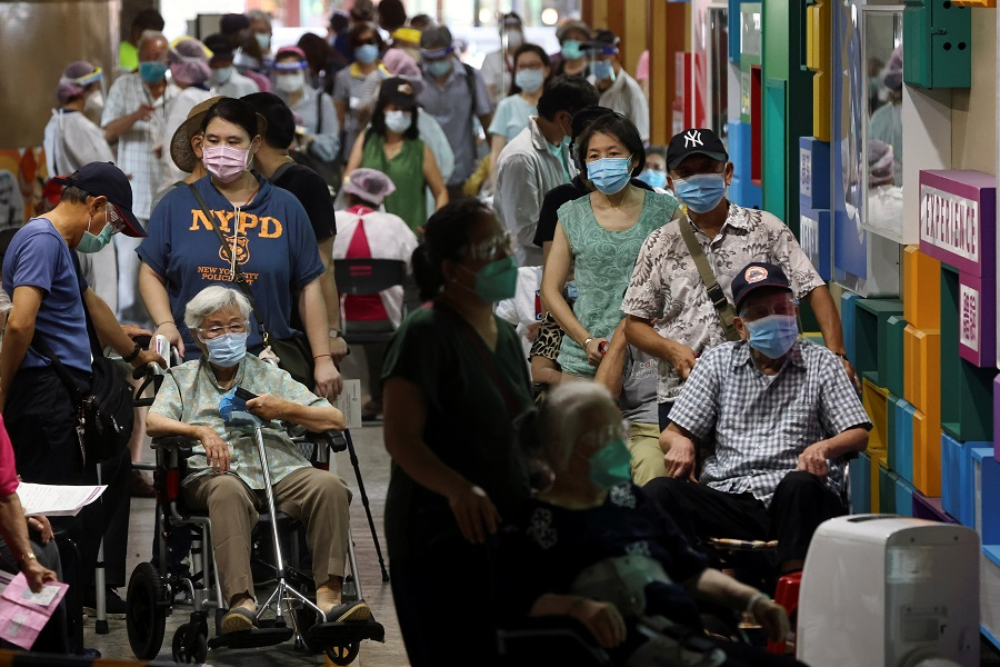 People wait during a vaccination session for elderly people over 85 years old at a school following the Covid-19 outbreak in Taipei, Taiwan, 15 June 2021. (Ann Wang/Reuters)