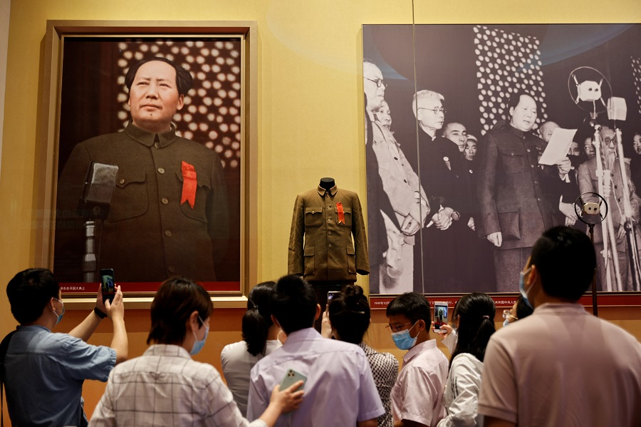 People look at images of late Chinese chairman of the Chinese Communist Party Mao Zedong at the Museum of the Communist Party of China that was opened ahead of the 100th founding anniversary of the Party in Beijing, China, 25 June 2021. (Thomas Peter/Reuters)