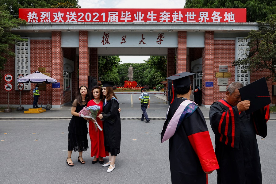 Students take graduation photos at Fudan University in Shanghai, China, 25 June 2021. (Aly Song/Reuters)