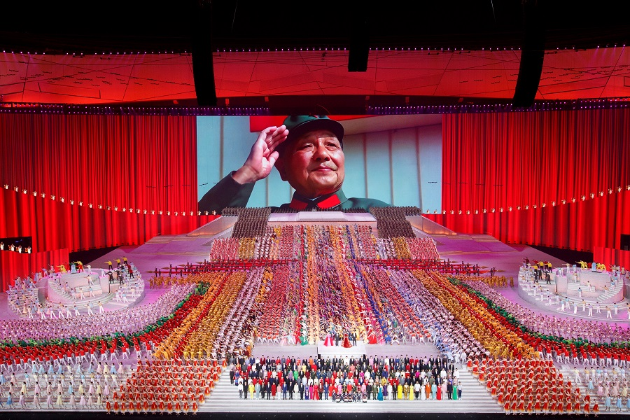 A screen shows late Chinese leader Deng Xiaoping during a show commemorating the 100th anniversary of the founding of the Communist Party of China at the National Stadium in Beijing, China, 28 June 2021. (Thomas Peter/Reuters)