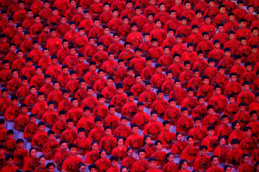Performers take part in a show commemorating the 100th anniversary of the founding of the Communist Party of China at the National Stadium in Beijing, China, 28 June 2021. (Thomas Peter/Reuters)