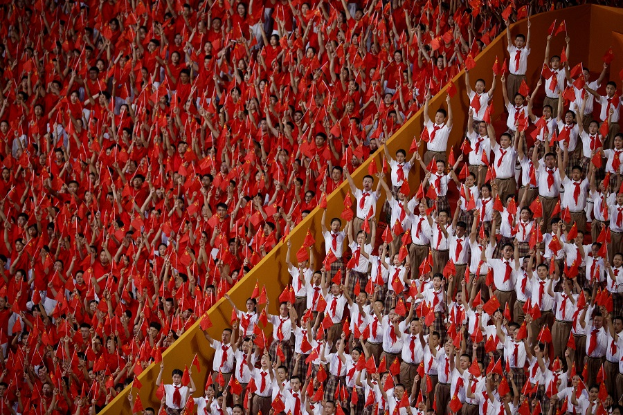 Spectators attend a performance commemorating the 100th anniversary of the founding of the Communist Party of China at the National Stadium in Beijing, China, 28 June 2021. (Thomas Peter/Reuters)