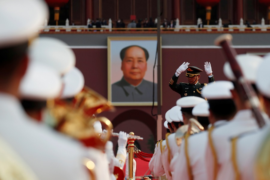 Military band members practice before the event marking the 100th founding anniversary of the Communist Party of China, in front of a portrait of late Chinese chairman Mao Zedong on Tiananmen Square in Beijing, China, 1 July 2021. (Carlos Garcia Rawlins/Reuters)