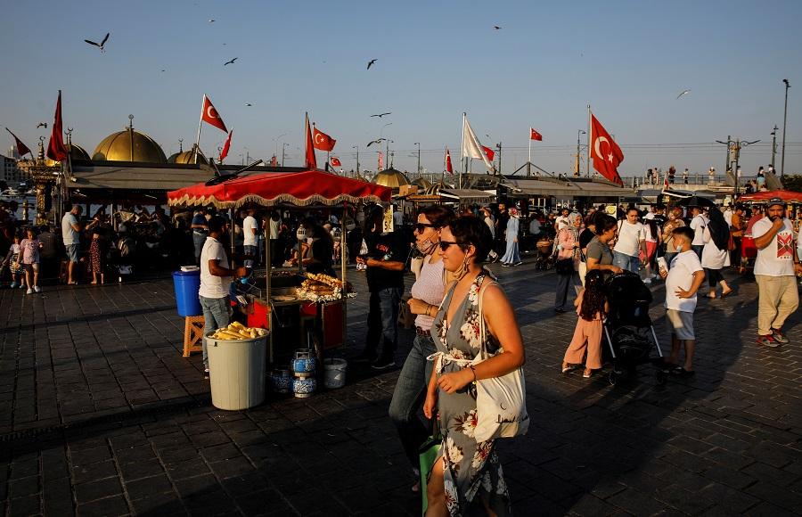 People walk along Eminönü district in Istanbul, Turkey, 12 July 2021. (Umit Bektas/Reuters)