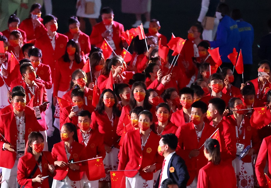 Athletes from China are seen during the opening ceremony of the Tokyo 2020 Olympics, 23 July 2021. (Lucy Nicholson/Reuters)
