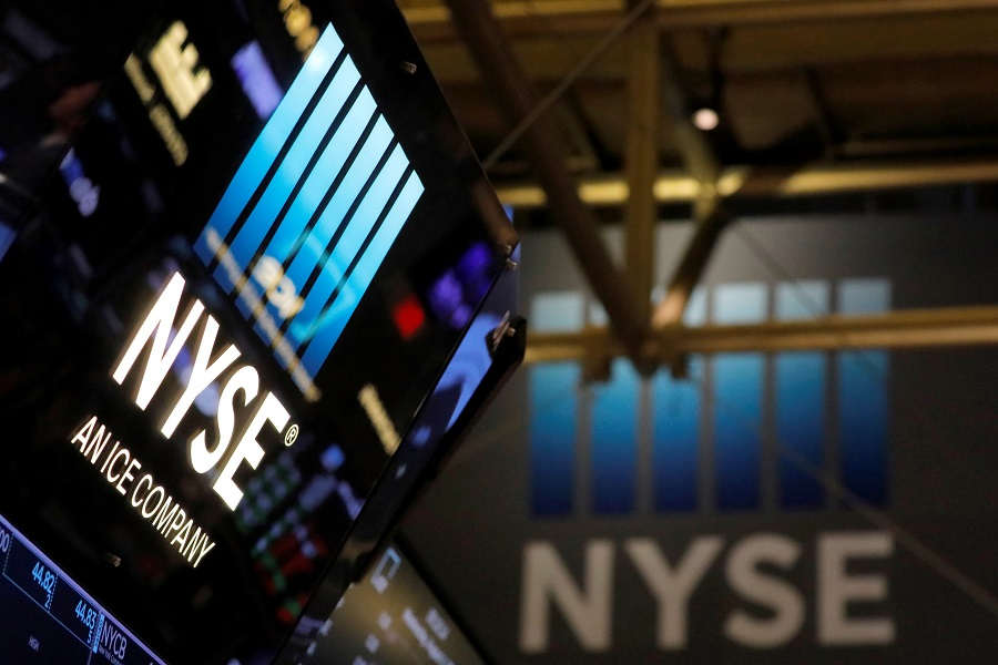 Signage is seen on the trading floor at the New York Stock Exchange (NYSE) in Manhattan, New York City, US, 4 August 2021. (Andrew Kelly/Reuters)