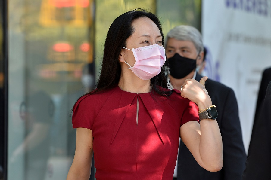 Huawei chief financial officer Meng Wanzhou leaves the court, where she attends a hearing, during a lunch break, in Vancouver, Canada, 10 August 2021. (Jennifer Gauthier/Reuters)