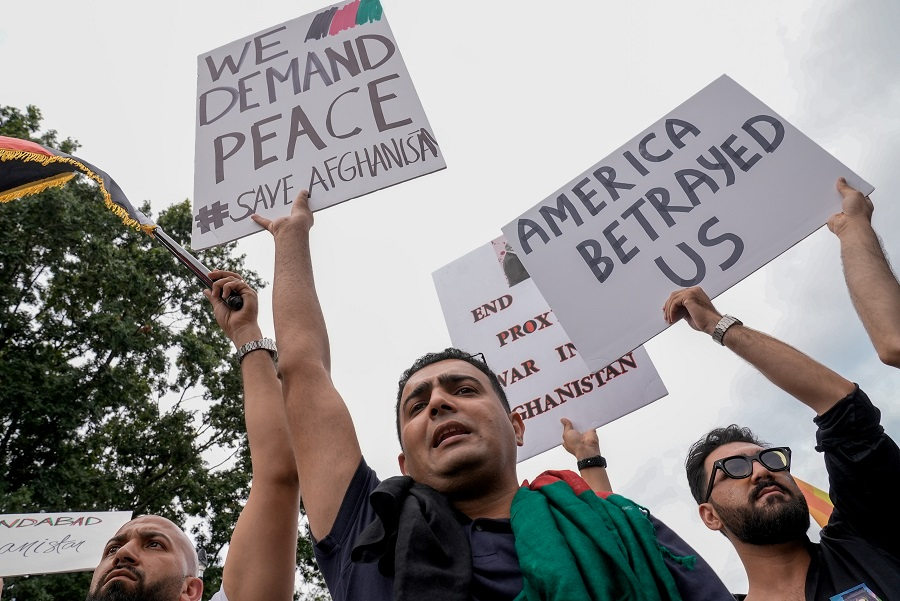 People crowd together in support of Afghanistan and against the Taliban, in front of the White House in Washington, US, 15 August 2021, on the day Taliban insurgents entered Afghanistan's capital Kabul. (Ken Cedeno/Reuters)