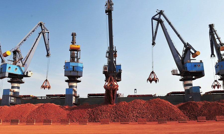 A ship carrying bauxite from Guinea is unloaded at a port in Yantai, Shandong province, China, 15 May 2017. (Stringer/File Photo/Reuters)