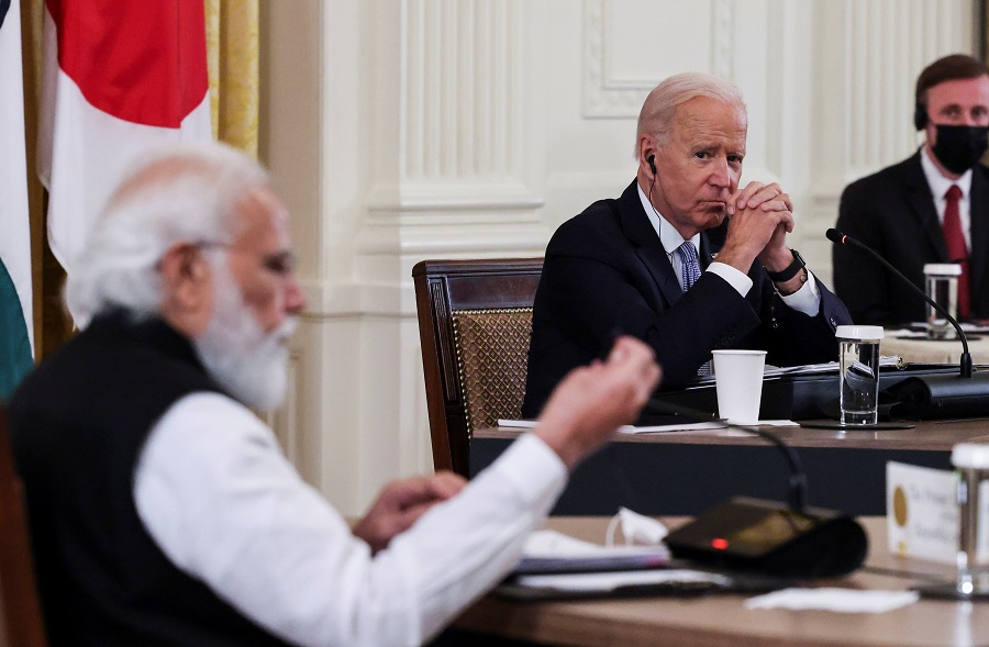 US President Joe Biden listens as Indian Prime Minister Narendra Modi speaks during a 'Quad nations' meeting at the Leaders' Summit of the Quadrilateral Framework held in the East Room at the White House in Washington, US, 24 September 2021. (Evelyn Hockstein/Reuters)