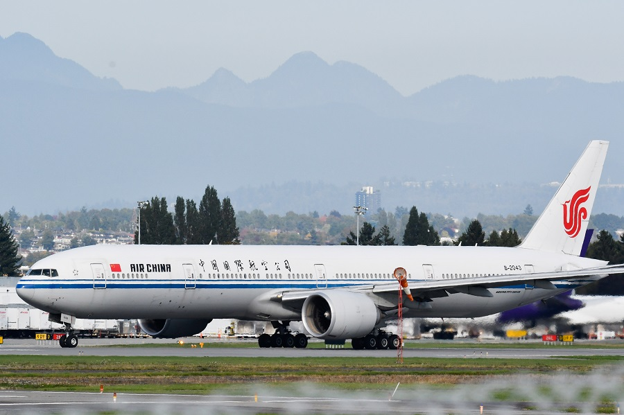 An Air China flight bound for Shenzhen, believed to be carrying Huawei CFO Meng Wanzhou, takes off from Vancouver International Aiport in Richmond, British Columbia, Canada, 24 September 2021. (Jennifer Gauthier/Reuters)