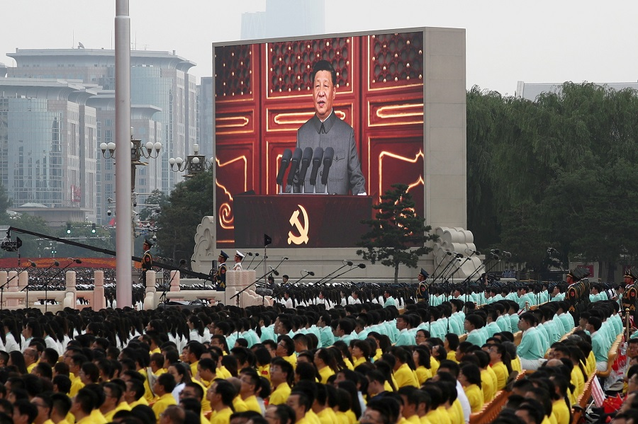 Chinese President Xi Jinping is seen on a giant screen as he delivers a speech at the event marking the 100th founding anniversary of the Communist Party of China, on Tiananmen Square in Beijing, China, 1 July 2021. (Carlos Garcia Rawlins/File Photo/Reuters)