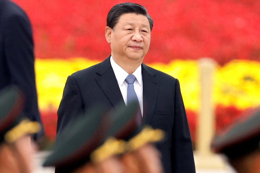 Chinese President Xi Jinping arrives for a ceremony at the Monument to the People's Heroes on Tiananmen Square to mark Martyrs' Day, in Beijing, China, 30 September 2021. (Carlos Garcia Rawlins/Reuters)
