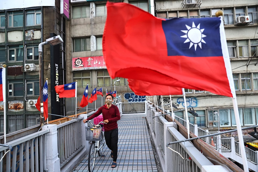 A man walks on an overpass decorated with Taiwan flags to celebrate the upcoming Double Tenth Day in Taipei, Taiwan, 7 October 2021. (Ann Wang/Reuters)