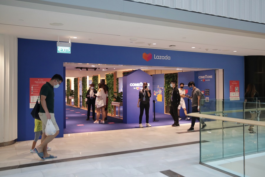 Shoppers browsing home decor items and appliances at the newly opened Lazada store located in Raffles City, Singapore on 3 April 2021. (SPH)