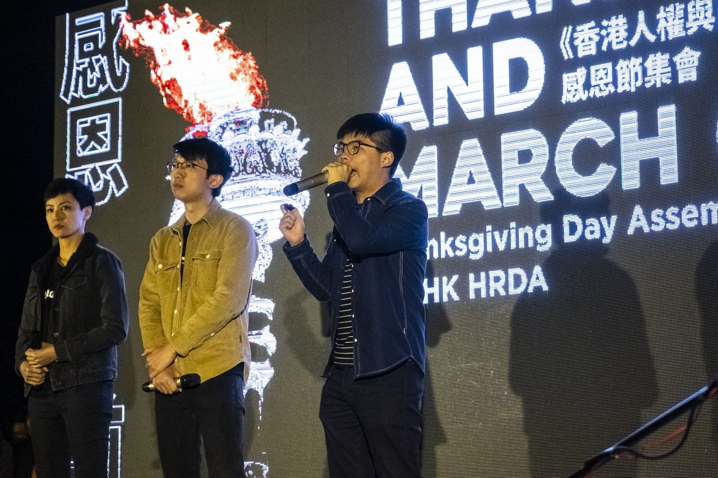 "Joshua Wong, co-founder of the Demosisto political party, delivers a speech during the ""Thanksgiving Day Assembly for Hong Kong Human Rights and Democracy Act"" at Edinburgh Place in the Central district of Hong Kong, China, on Thursday, Nov. 28, 2019. Donald Trump signed legislation expressing U.S. support for Hong Kong protesters, prompting China to threaten retaliation just as the two nations get close to signing a phase one trade deal. Photographer: Chan Long Hei/Bloomberg"