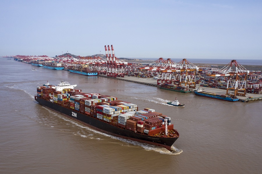 The ZIM Integrated Shipping Services Ltd. Chicago container ship sails out of the Yangshan Deepwater Port in this aerial photograph taken in Shanghai, China, on 23 March 2020. (Qilai Shen/Bloomberg)