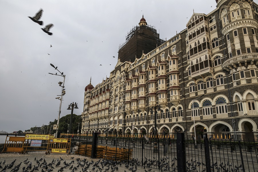 The Taj Hotel stands beyond a deserted street during a lockdown imposed due to the coronavirus in Mumbai, India, on 1 June 2020. (Dhiraj Singh/Bloomberg)