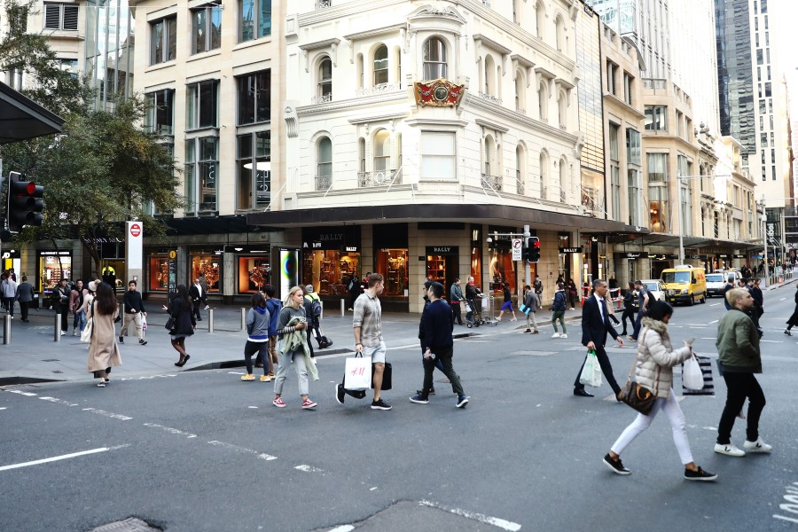 Pedestrians and shoppers cross a road at Pitt Street Mall in Sydney, Australia, on 3 June 2020. (Brendon Thorne/Bloomberg)
