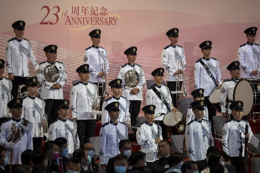 Members of a brass band prepare to perform at a ceremony to mark the 23rd anniversary of Hong Kong's return to Chinese rule in Hong Kong, China, on 1 July 2020. (Paul Yeung/Bloomberg)