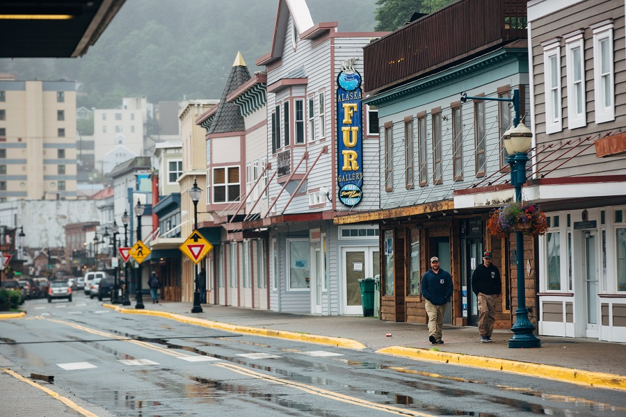 Pedestrians walk past closed seasonal stores on South Franklin Street in Juneau, Alaska, US, on 22 July 2020. (Meg Roussos/Bloomberg)