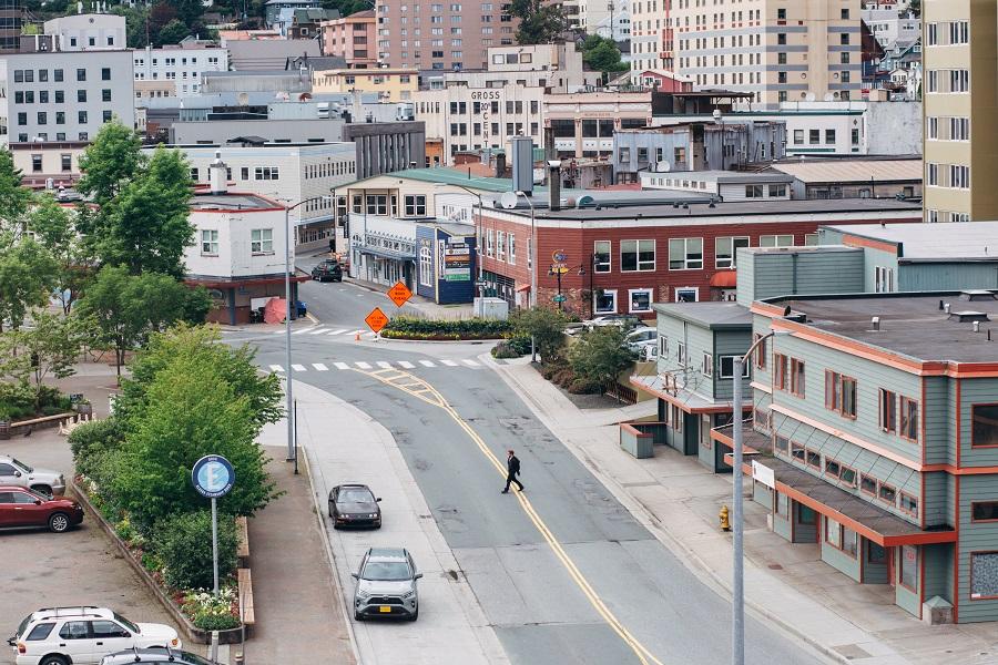 A pedestrian crosses an empty street in downtown Juneau, Alaska, US, on 22 July 2020. (Meg Roussos/Bloomberg)