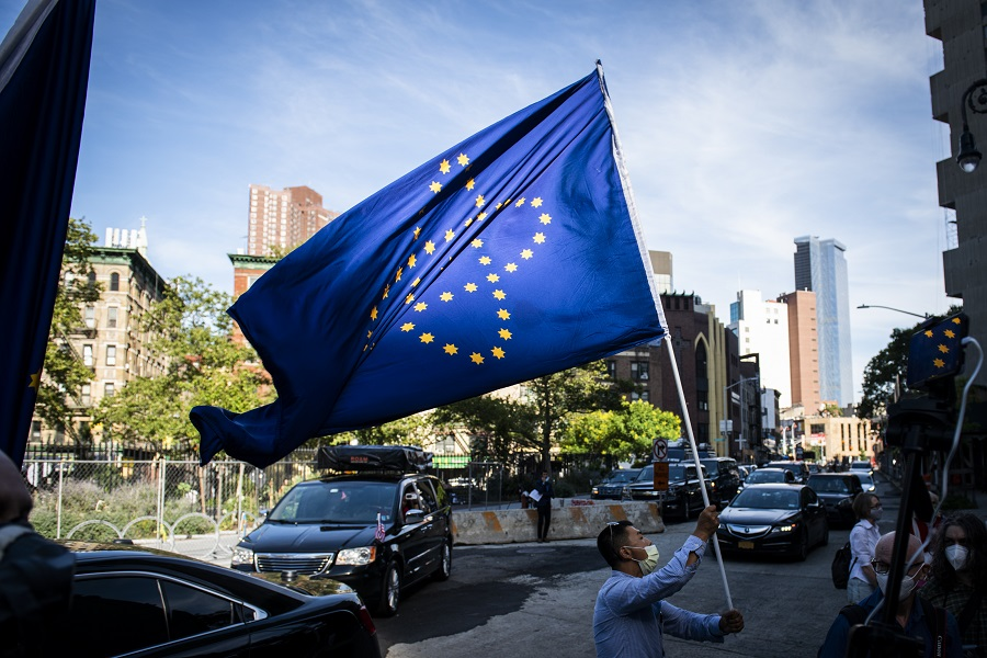 A supporter of the New Federal State of China waves a flag as they wait for Steve Bannon to depart from federal court in New York, US, on 20 August 2020. (Mark Kauzlarich/Bloomberg)