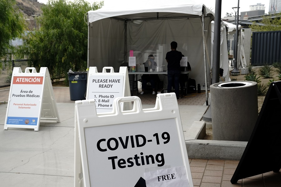"""A """"Covid-19"""" sign at a coronavirus testing site at the San Ysidro Port of Entry in San Diego, California, US, on 25 August 2020. (Bing Guan/Bloomberg)"""