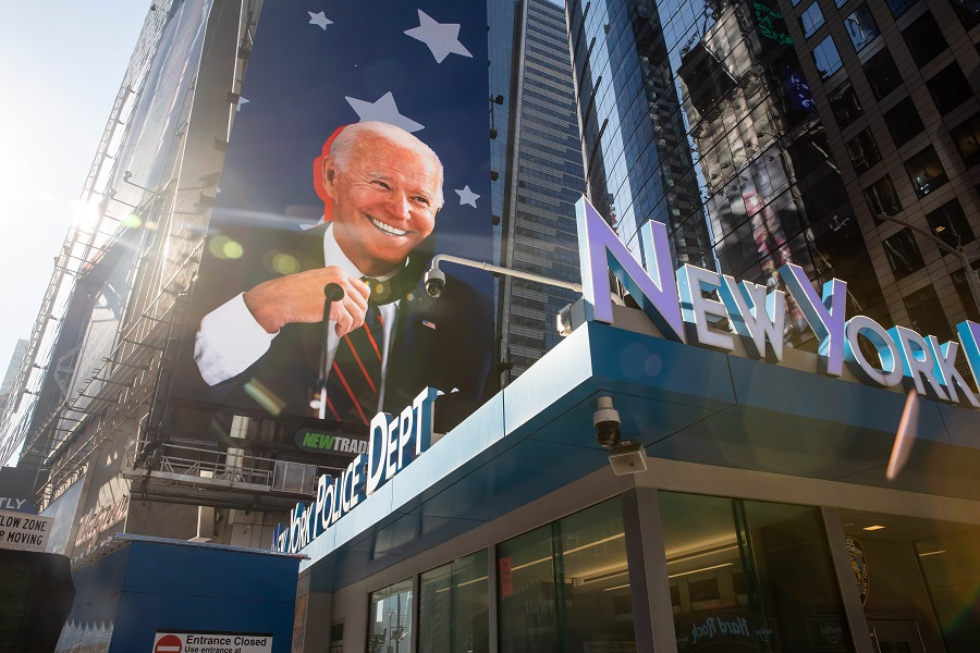 An image of US President-elect Joe Biden on a screen in the Times Square area of New York, US, on 9 November 2020. (Michael Nagle/Bloomberg)