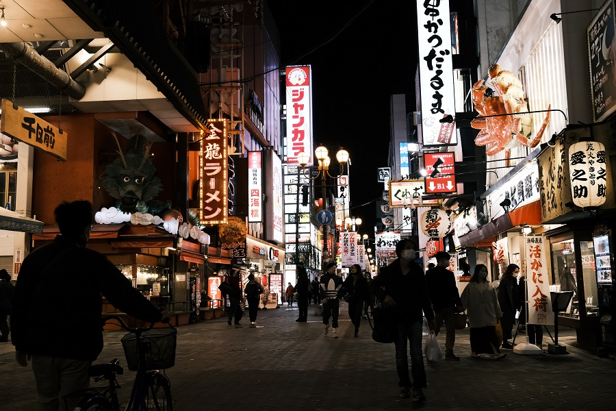 People walk through a street in the Namba district of Osaka, Japan, on 29 November 2020. (Soichiro Koriyama/Bloomberg)