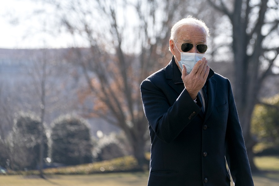 US President Joe Biden wears a protective mask while speaking to members of the media on the South Lawn of the White House after arriving on Marine One in Washington, DC, US, on 8 February 2021. (Stefani Reynolds/Bloomberg)