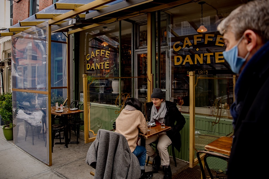 People eat outdoors at Caffé Dante in the Greenwich Village neighborhood of New York, US, on 12 February 2021. (Amir Hamja/Bloomberg)