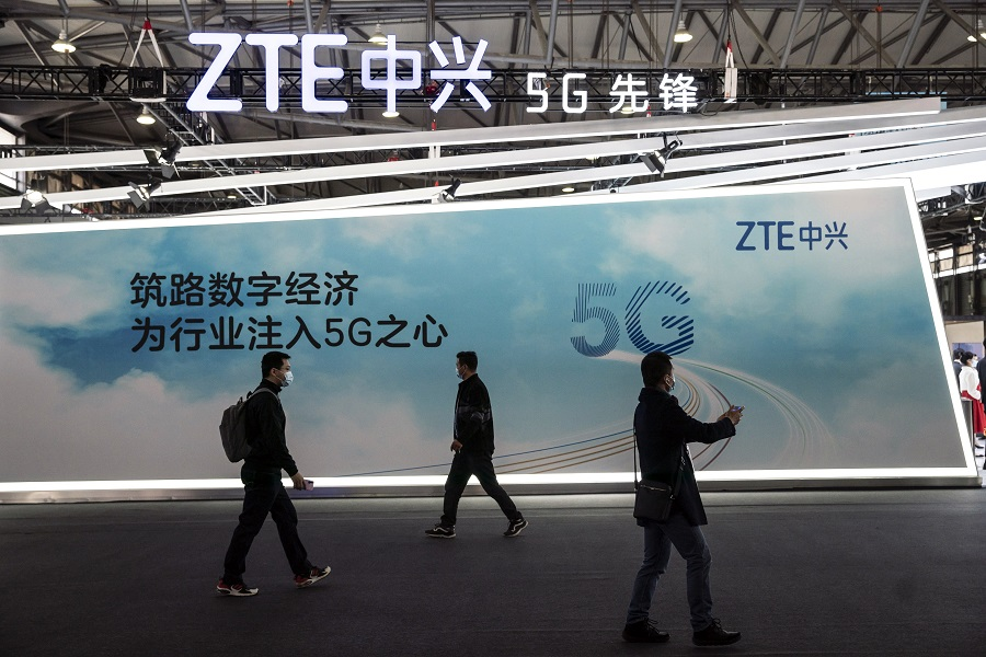 Attendees walk past signage for 5G at the ZTE Corp. booth at the MWC Shanghai exhibition in Shanghai, China, on 23 February 2021. (Qilai Shen/Bloomberg)